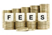 Stack of coins with 'fees' written on it
