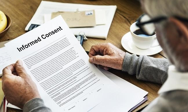 Man looking at Informed Consent Document
